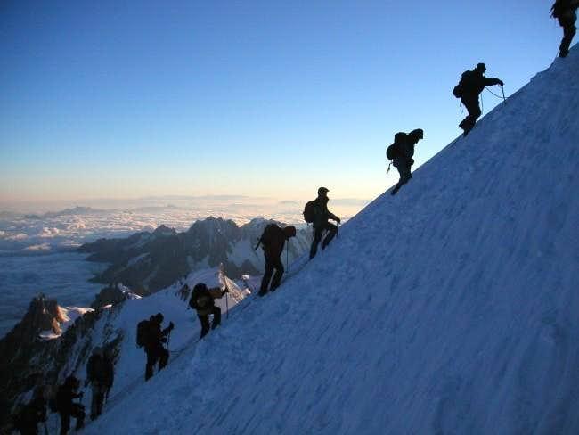 A row of climbers on the last...