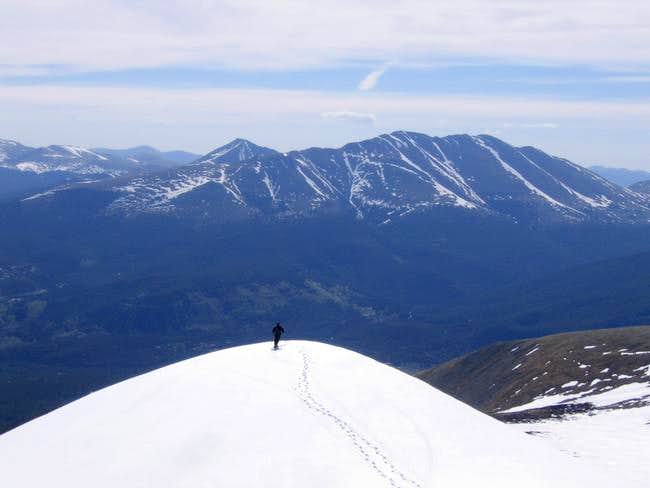 A skier on the lower summit...