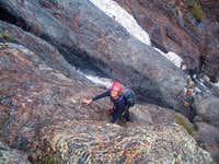 Sharon climbing up rock slabs...