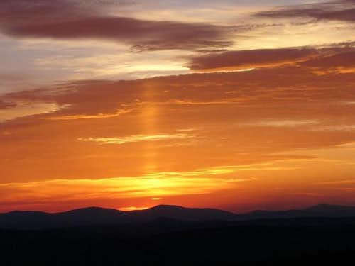 Sunset and sun pillar with...