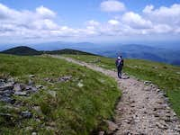 Strolling over the summit on a gorgeous day in the mountains