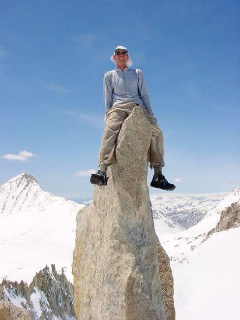Matthew sits atop the summit...