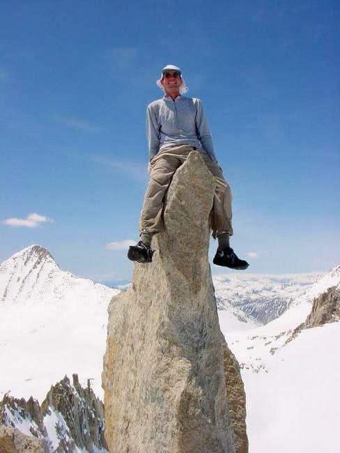 Matthew sits atop the summit...