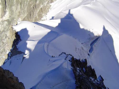 Climbers under the shadow of...