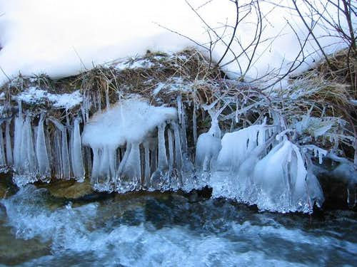 Frozen water of a stream, on...