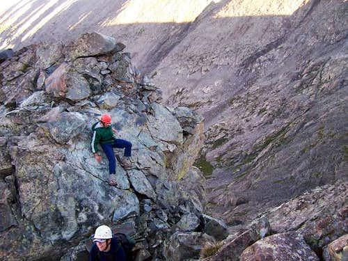 Climbers downclimbing an...