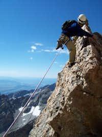 Kelby Fischer climbing (or...
