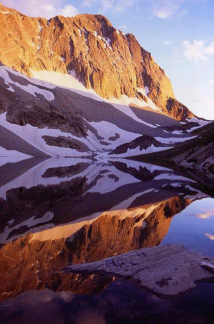 Capitol Peak watches as the...
