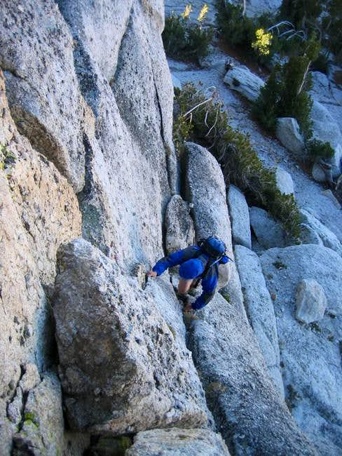 Glenn downclimbing from the...
