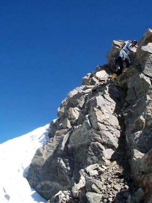 Dan Shadd downclimbing one of...