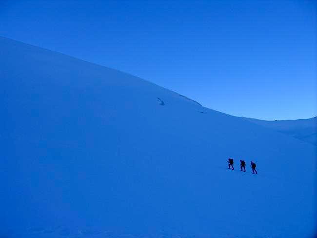 Three mountaineers walking...
