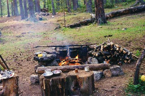 Camp fire and kitchen at...
