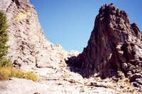 West Gully. Climb face of...
