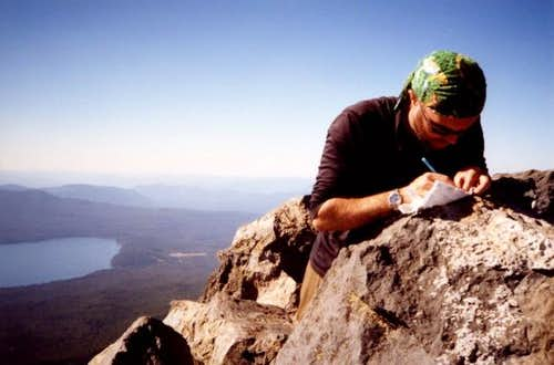 Ty signing the summit log.