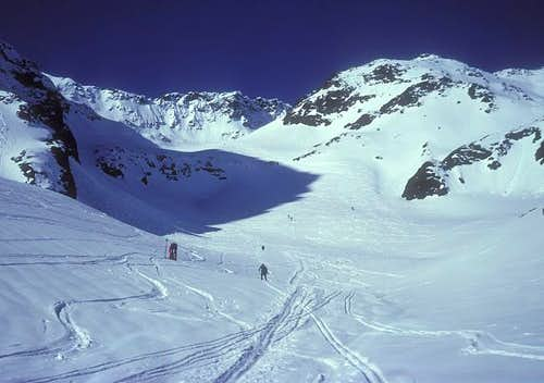 climbing the ski route to...