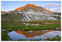 Gilpin Peak reflects an...