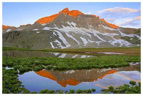 Gilpin Peak reflects an...