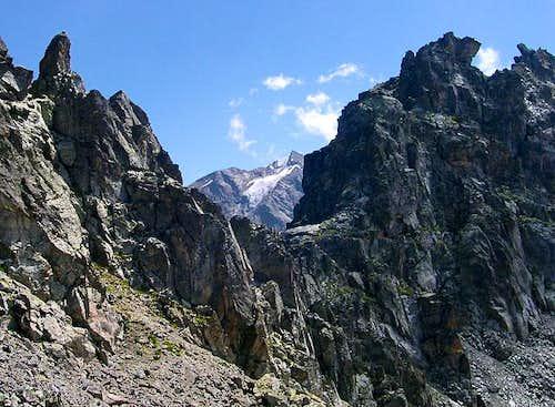 Mont Paramont 3301m viewed through a notch of the Denti d'Ameran
