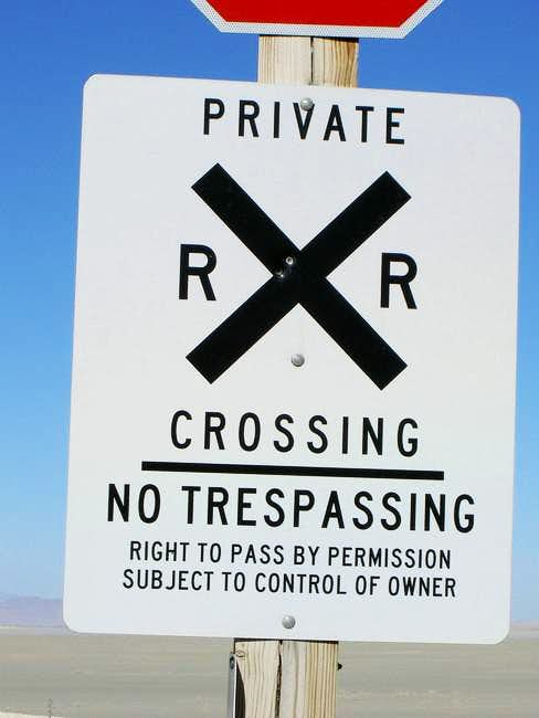 The sign at the railroad.