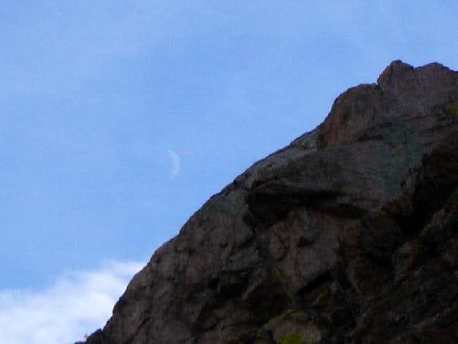 A young crescent moon seen...