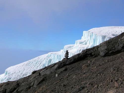 glacier with rock sculpture