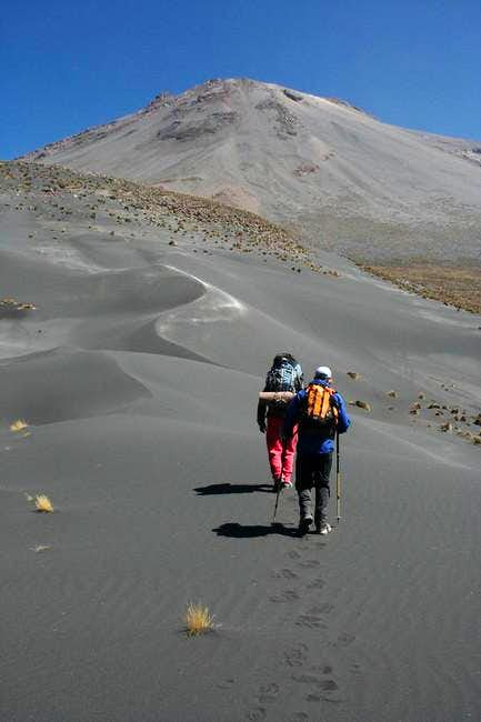 Up the volcanic sand towards...