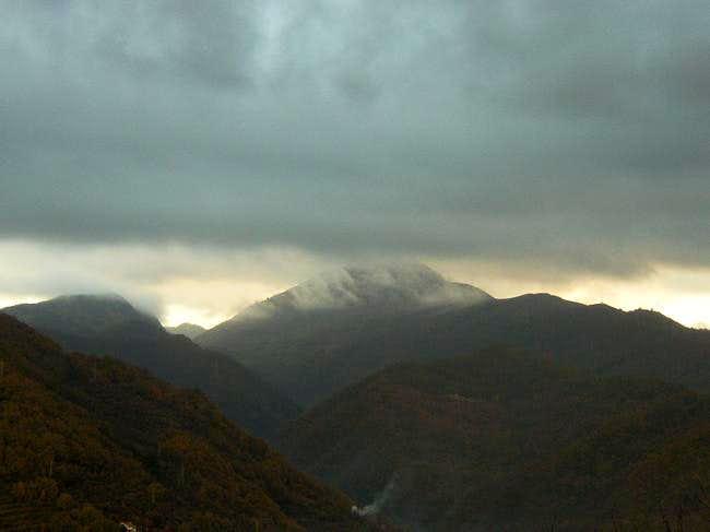 Alpesisa under clouds in a...