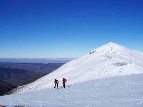 Mountain skiers getting to...