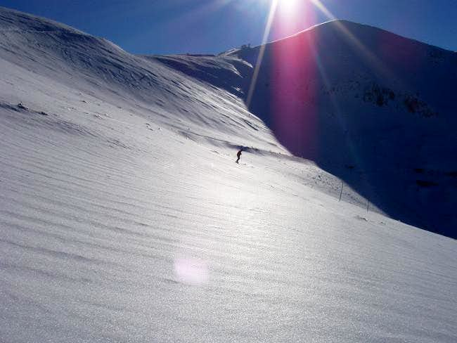 A skier on the slopes below...