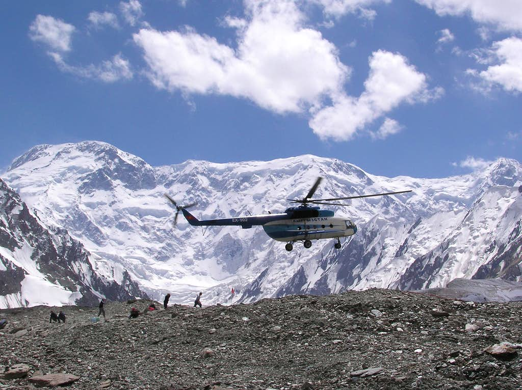 Helicopter arrives at Khan Tengri and Pik Pobeda's base camp