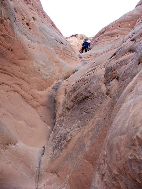 Downclimbing the crack to...