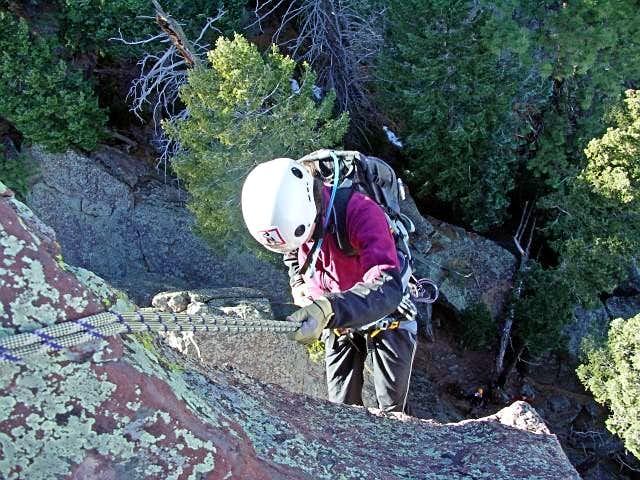 Kristin rappels from the Summit