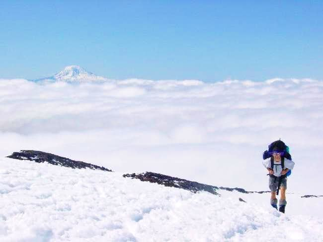 Above the clouds, climbing to...