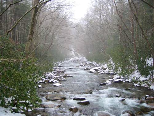 Creek with snowfall on the...