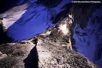 Robert Meshew climbing on the...