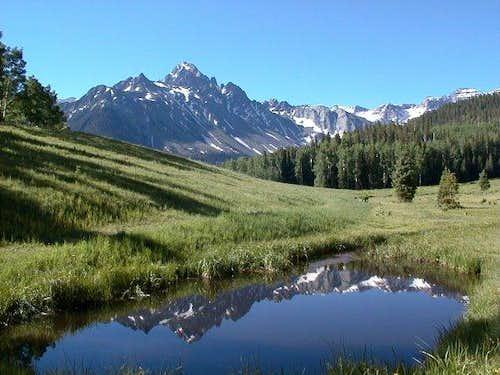 A reflective Mount Sneffles...
