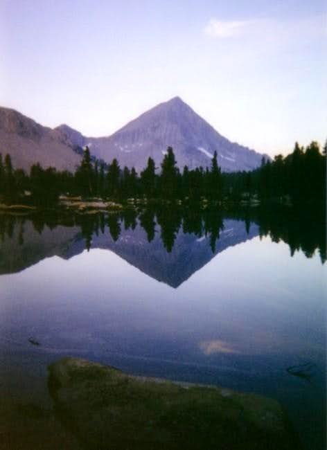Arrow Peak reflected in Bench...