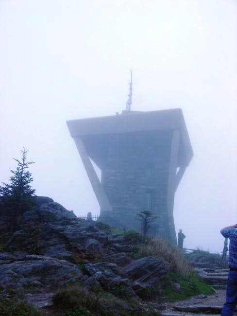 Tower on summit. Foggy day.