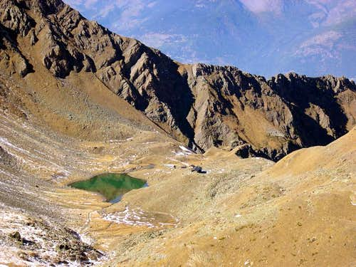 Arbolle Hut and Lake from Col Garin.<br>In the background Colle di Chamolè
