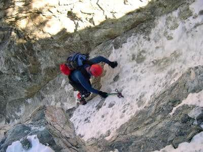 Mike Ostby climbing one of...