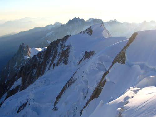 Mont Blanc du Tacul(center),Aig. du Midi(left),Grandess Jorasses in the background.Descent on Monte Bianco.7/2005