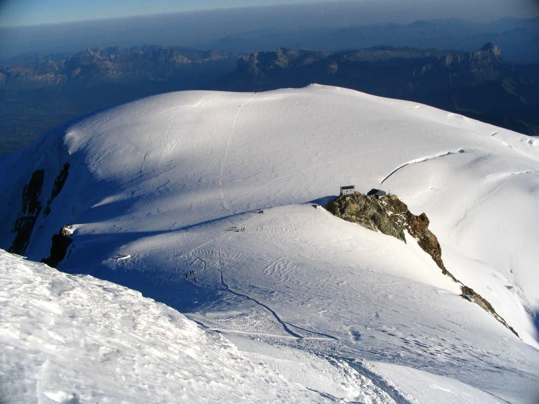 Descent from Monte Bianco,view of Refuge Vallot and summit of Dome du Gouter(left).7/2005