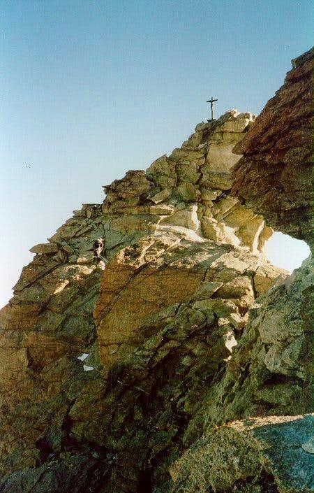 Climber approaching the Zinalrothorn summit cross