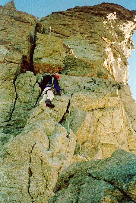 Climber on the rocks above the Gabel Notch