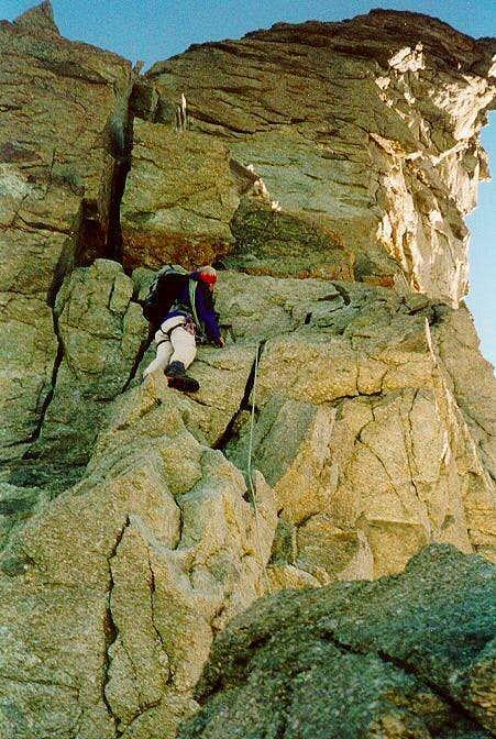 Climber on the rocks above the Gabel Notch