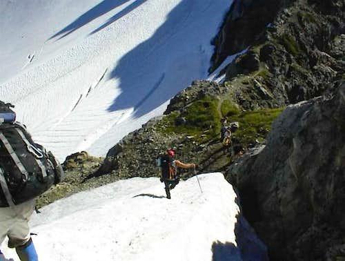 Downclimbing towards the...