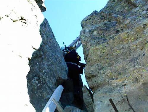 Doug Climbs up the last of 3...