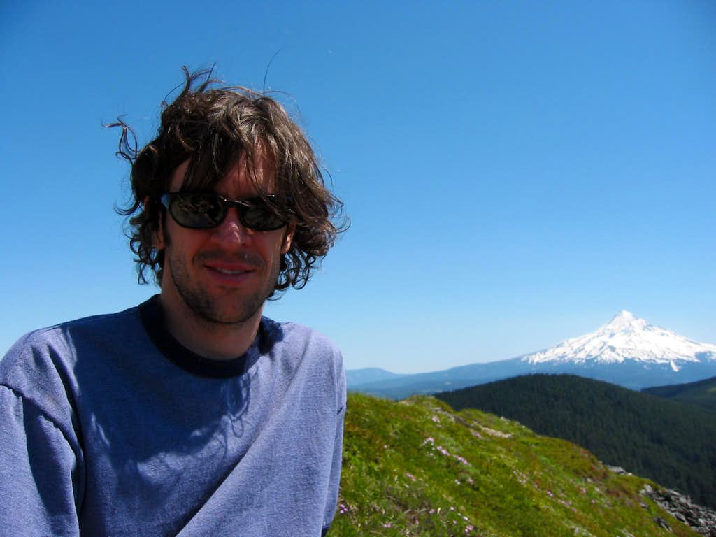 Jason at the summit of Chinidere Mt. with view of Mt. Hood