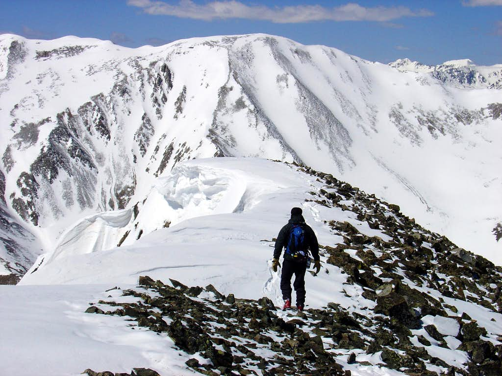 Descending the summit ridge