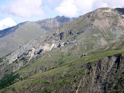 The buildings of the disused Colonna Mine <i>2387m</i> on the slope of Montzalet <i>2759m</i>